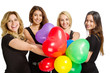 Girls having a party with baloons