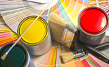 Sample of colorful paint. Cans of red, yellow and green paint.