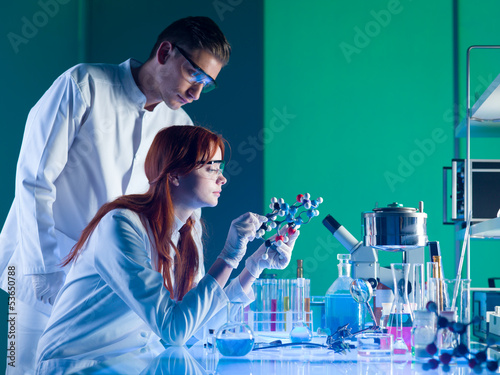 scientists studying a molecular structure