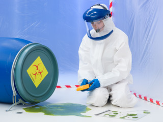 specialist measuring level of contamination