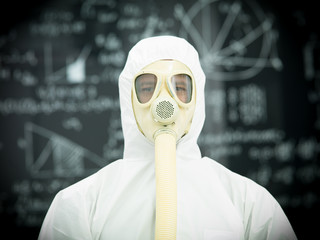 protective geared person in front of blackboard