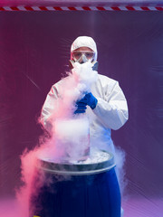 scientist experimenting with vapors on blue barrel