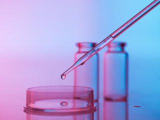 laboratory glassware with tranparent liquid in pipette