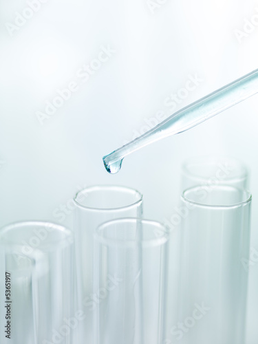 Liquid drop from pipette to test tubes