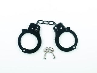 A pair of handcuffs with two keys