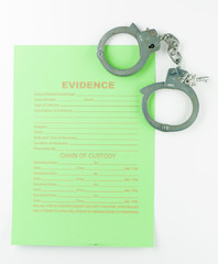 evidence form and hancuffs