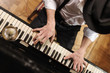 Постер, плакат: Talent and virtuosity Top view of handsome young men playing pi