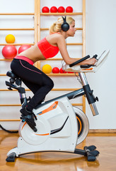 woman on stationary speed bike