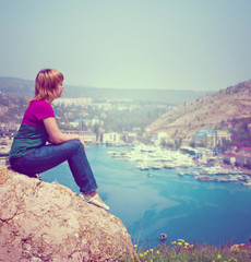 lonely young girl admires a beautiful view