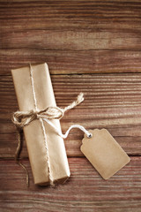 Gift box on rustic wooden table