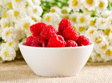 Raspberries and flowers