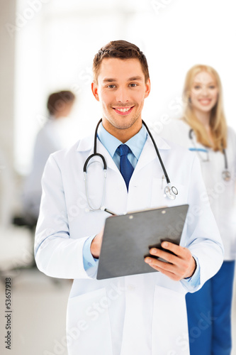 male doctor writing prescription