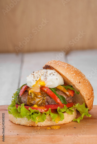 Hamburger with poached egg and vegetables
