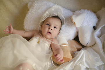 Bbay with christening cap lying