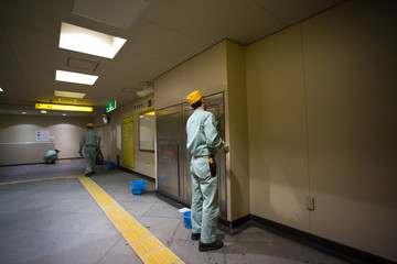 Group of cleaners cleaning the subway of Tokyo,