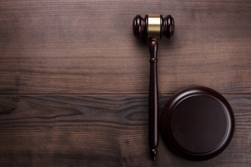 judge gavel on brown wooden background