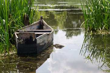 Old traditional wooden rowboat a beautiful lake