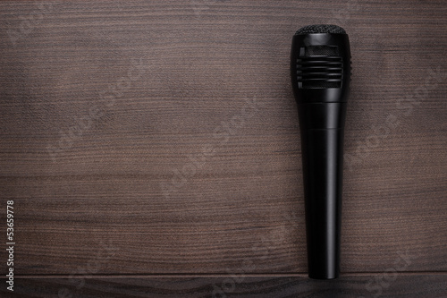 black mic on the wooden table
