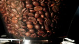 Fragrant coffee beans in grinder