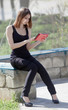 Girl uses touchpad on open air