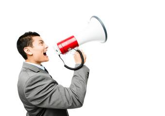 Crazy Asian businessman screaming in megaphone on white backgrou