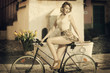 funny portrait of girl on bicycle