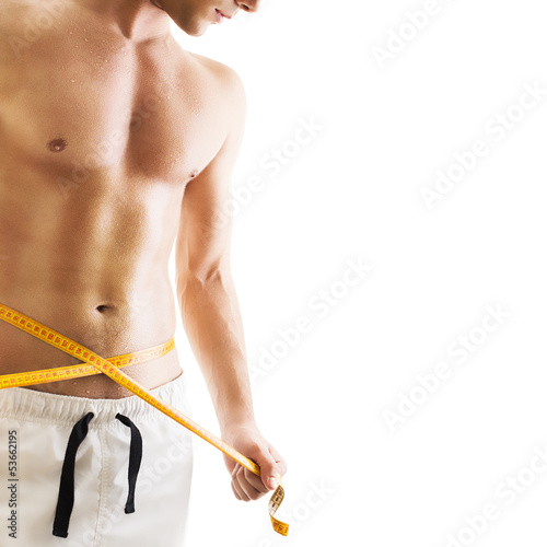 Hansome young man with measuring tape