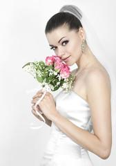 Beautiful brunette woman as bride