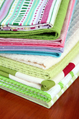 Kitchen towels, on wooden background