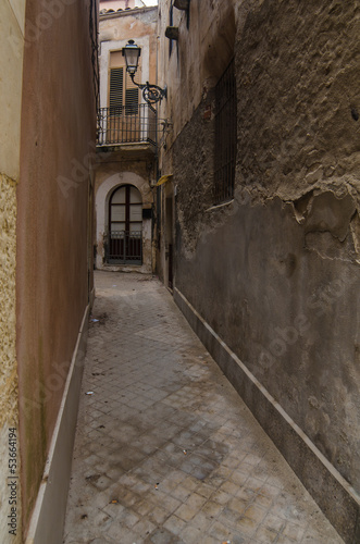 Narrow street in Syracuse, Sicily, Italy