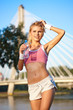 Sporty fitness woman outdoor workout. Young runner woman smiling