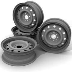 Автомобильные штампованные диски на белом фоне