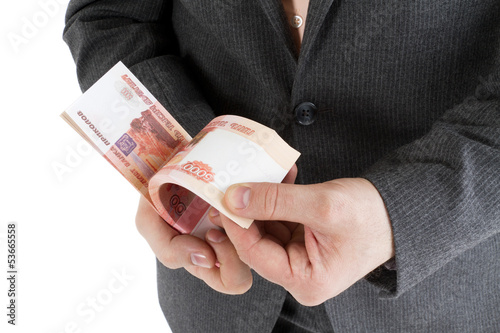 stack banknotes of 5000 rubles in male hands