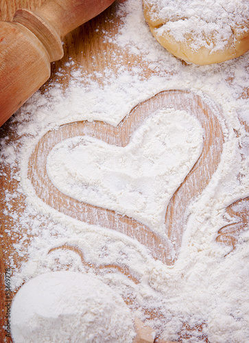 Heart drawn with flour on the kitchen table