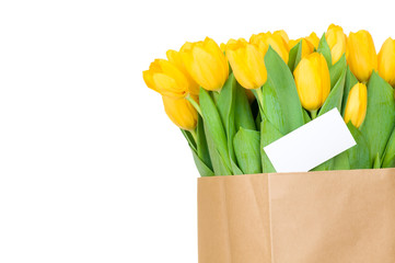 Tulips in the paper bag and greeting card