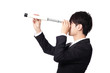 Businessman with telescope looking forward