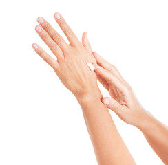 Hands applying moisturize cream.