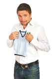 Surprised man holding shrunk vest
