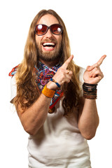 Happy and silly hippie man pointing up at copyspace.