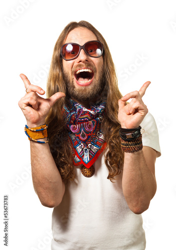 Fun portrait of a surprised hippy man pointing up at copyspace.