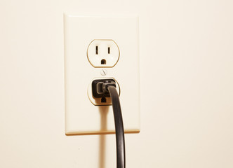 A plug connected to an electrical outlet