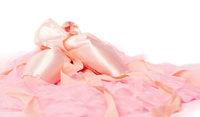 ballet shoes on a pink cloth isolated