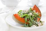 Pumpkin salad with arugula and cheese.