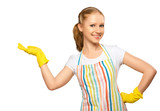 happy young housewife in glove with white empty billboard isolat