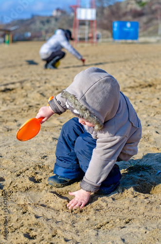 Cute child playing on the beach