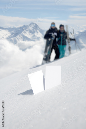 Two ski admission tickets in snow