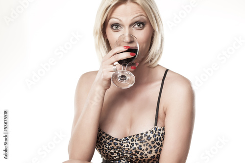 pretty blonde drinks wine from wine glass