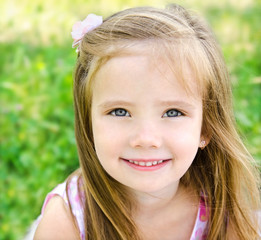 Cute smiling little girl on the meadow