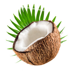 Coconut half with leaf on a white background