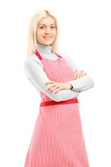 Smiling blond female wearing an apron and looking at camera